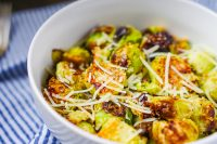 These oven roasted Brussels sprouts are lightly seasoned with garlic and parmesan, resulting in a winning flavor combination the whole family will love! Fresh, crunchy and so easy to make, this Brussels sprouts side dish is a winner!