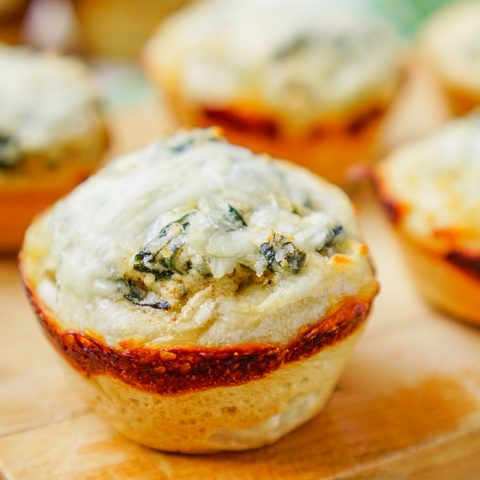 It doesn't get much better than deliciously cheesy spinach dip stuffed inside warm french bread! These Individual Spinach Dip Bread Bowls make great party food and holiday appetizers!