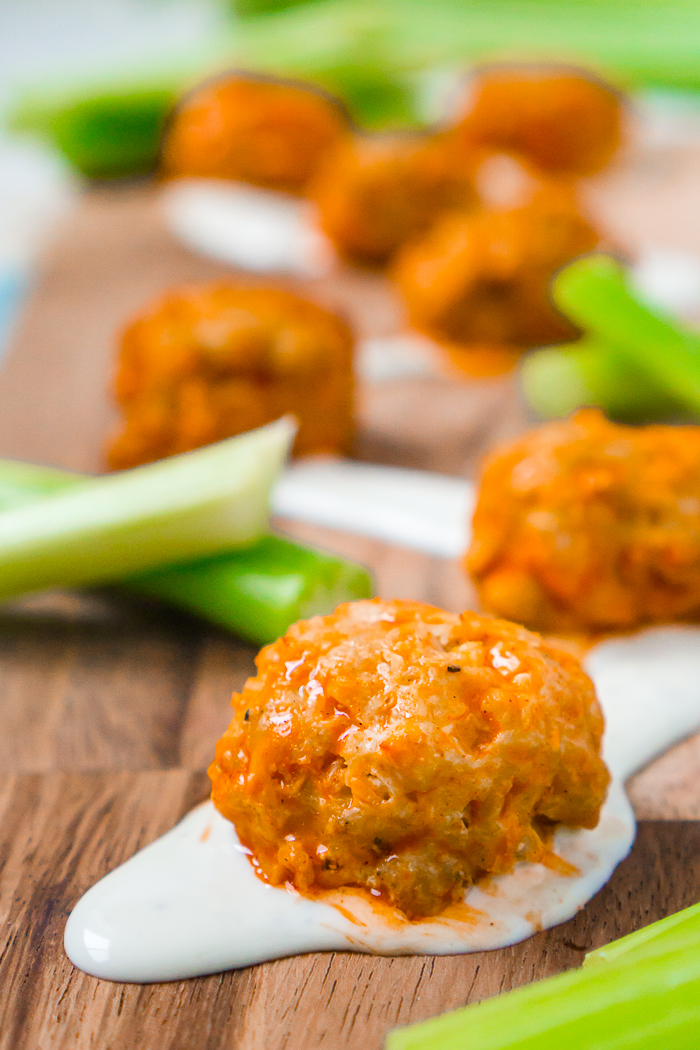 Slow Cooker Buffalo Chicken Meatballs are the perfect game day food! Healthier and cleaner to eat than buffalo chicken wings without losing any of the flavor!