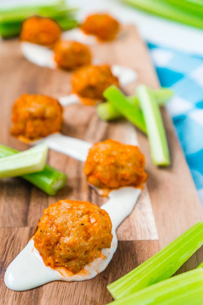 If you love Buffalo Chicken Wings, then you will love this lighter twist on the classic! Buffalo Chicken Meatballs in the slow cooker are full of flavor, made with homemade chicken meatballs and coated in our favorite buffalo sauce.