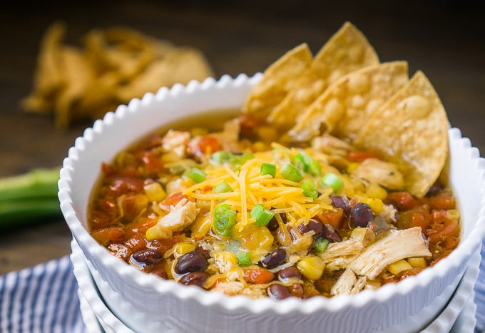 Make a super easy chicken tortilla soup in your slow cooker with less than 10 minutes of prep work! It's the only chicken tortilla recipe you'll need and makes dinner prep even easier with the ability to cook extra chicken with the coup for other meals during the week. Hearty, flavorful, and full of chicken, veggies and spices!