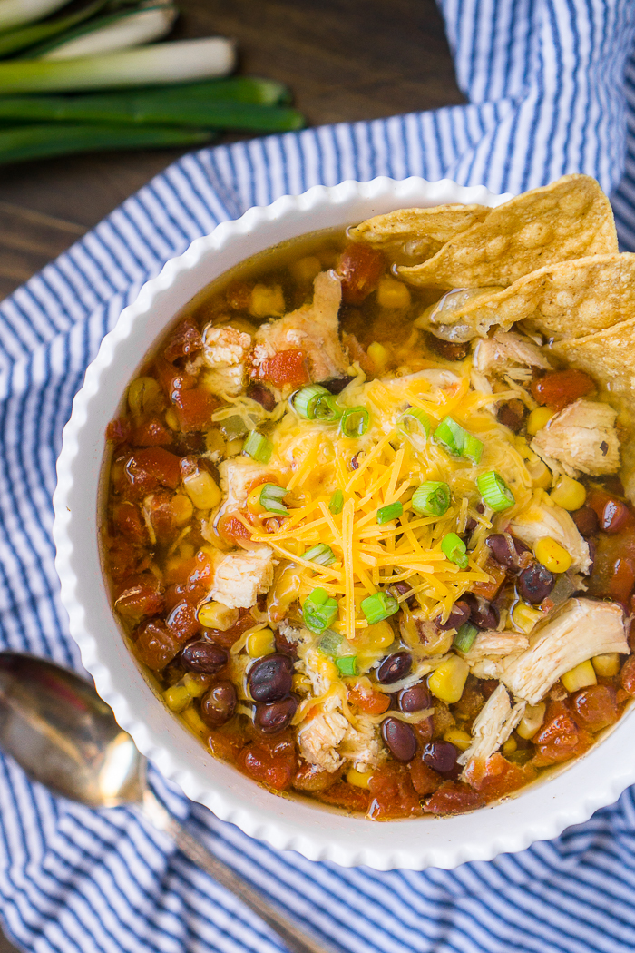 Easy Slow Cooker Chicken Tortilla Soup Recipe with10 minutes of prep work! Hearty, flavorful, and full of chicken, tomatoes, chiles, black beans, corn, low sodium Swanson chicken broth and spices!