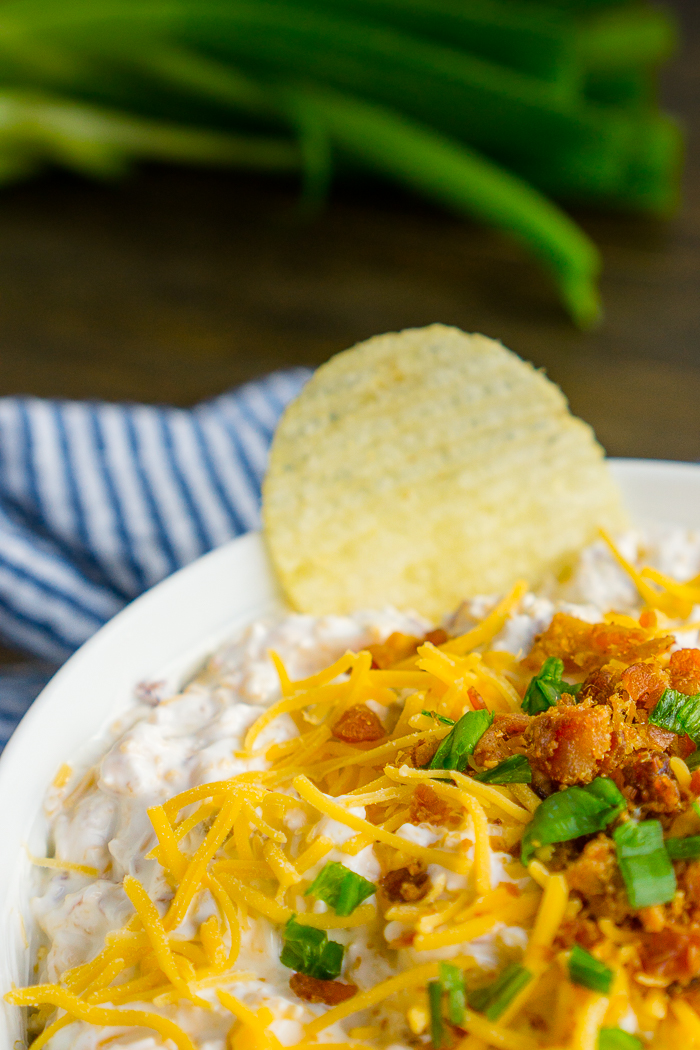 Loaded Baked Potato Chip Dip is our favorite potato chip dip recipe! It makes great game day food as sour cream is loaded with cheese, bacon, and green onions!