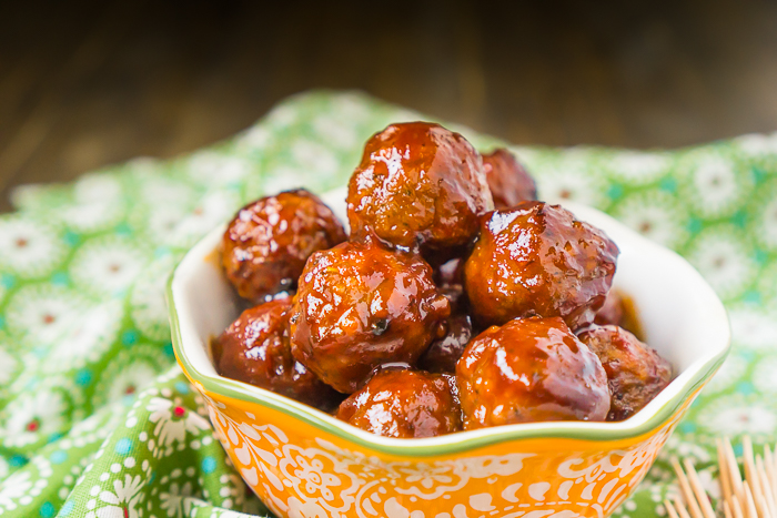 This recipe for Sweet and Sour Meatballs in the slow cooker is an incredibly easy meatball recipe that is always a big hit!! They make the perfect game day appetizer or easy dinner idea over rice!