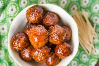 Sweet and Sour Meatballs Crock Pot Style with only a few key ingredients - grape jelly, chili sauce, cocktail meatballs and a little seasoning. It's an easy meatball recipe that is always a party food hit!!