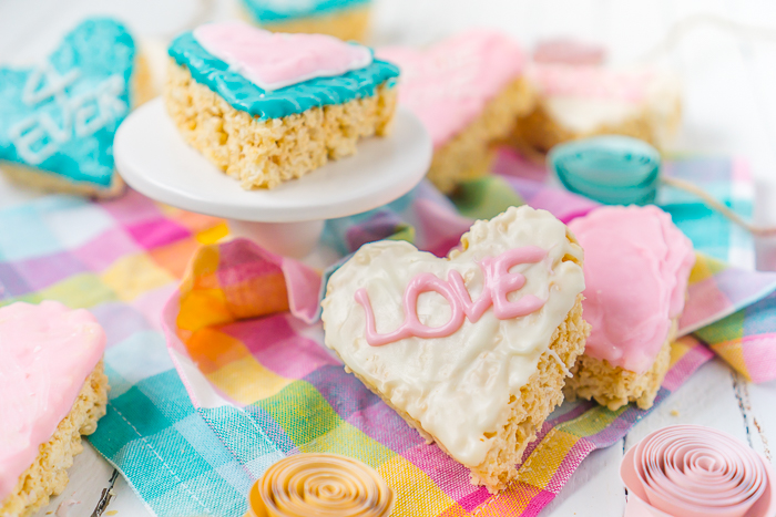 """Who's looking for cute Valentine's Day Treats for Kids?! These Conversation Heart Rice Krispie Treats are easy to make with only 5 ingredients and the end result are adorable """"chocolate"""" covered Valentine rice krispie treats everyone will love!"""