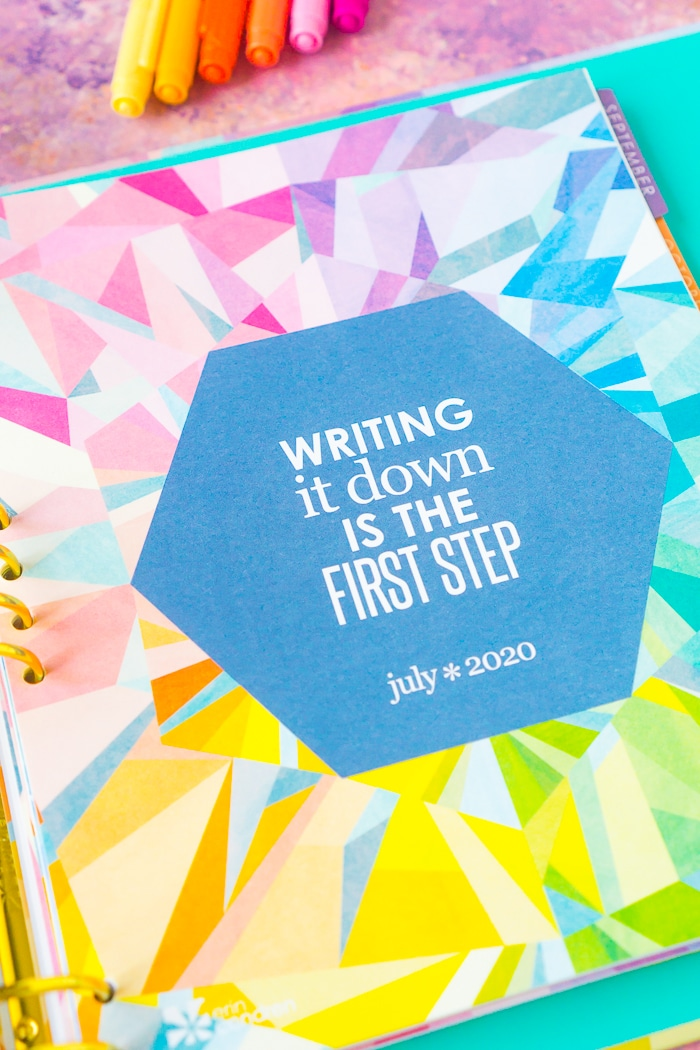 Erin Condren life Planner Month Page with quote: Writing it down is the first step