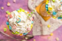 Lucky Charms recipes are perfect kid friendly recipes for St. Patrick's Day, especially this Lucky Charms Milkshake! Fun, colorful, and sweet - this milkshake recipe will be slurped up right before your eyes!