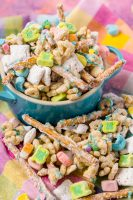 St Patrick's Day Puppy Chow with Lucky Charms Marshmallows and Cereal! A tasty St Patrick's Day recipe for kids that the whole family will love!