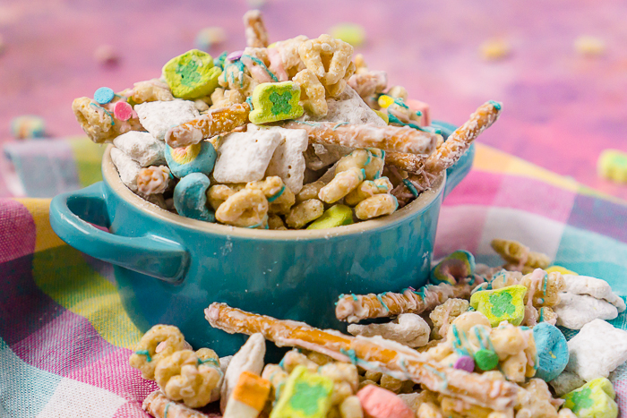 Lucky Charms Puppy Chow is a deliciously easy St Patrick's Day dessert recipe for the whole family! Kids and adults will both love this sweet and salty treat!