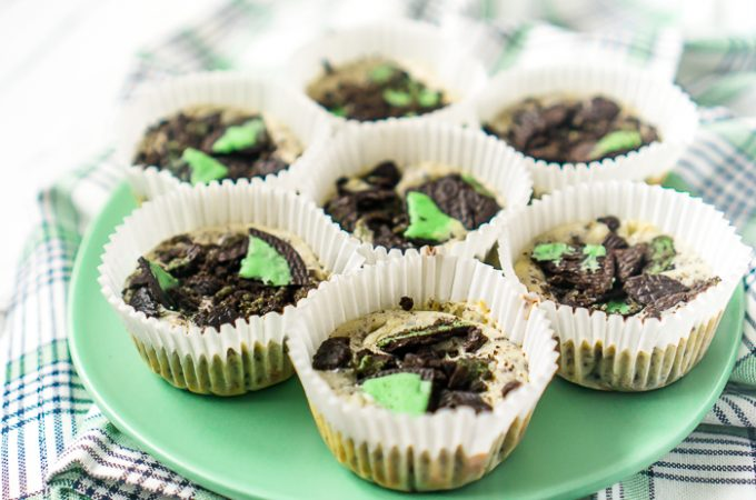 My obsession with mini cheesecakes continues with a tasty St. Patrick's Day Cheesecake recipe - Mint Oreo Cheesecake! A creamy cheesecake filling with crushed Oreos is baked on top of a Mint Oreo crust. Add a little extra Mint Oreo crumble on top for a touch of green on this St. Patrick's Day dessert everyone will love!