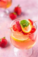 Wine Spritzer Recipe with rosé wine, fresh strawberries, lemons, and a mint garnish! Pretty, refreshing, and an incredibly easy cocktail recipe to make in just a few minutes!