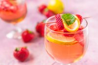 This Strawberry Rosé Spritzer is an extra lovely wine spritzer recipe thanks to the pretty pink hue from the rosé wine. Lightly and fruity, it's the perfect cocktail to enjoy for a special Valentine's Day date night or on a warm spring day!