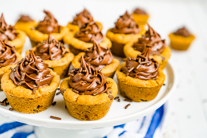 Frosted Chocolate Chip Cookie Cups combine two favorite sweets- chocolate chip cookies & chocolate fudge frosting! This dessert is ready in just 30 minutes.