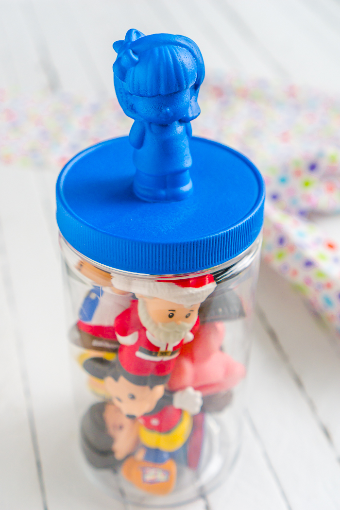 All parents know that the playroom can easily become a huge mess so I've created some colorful DIY Playroom Storage Containers! Create lids with easily identifiable toy labels in bright colors thanks to Plasti Dip.