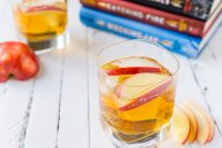 Celebrate Katniss Everdeen with this Hunger Games inspired cocktail - The Girl on Fireball Cocktail! OR just celebrate your love of perfect fall cocktail recipes and combine spiced Fireball Whiskey with tasty cider! | THE LOVE NERDS #fireballwhiskey #fallcocktail