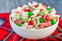 Let's not leave the reindeers out this holiday season by making them their own special Reindeer Chow {aka Christmas Puppy Chow}! This holiday party mix recipe is filled with festive white, red, and green to celebrate the season!! Perfect for your Christmas parties or gift exchanges with neighbors and friends. | The Love Nerds