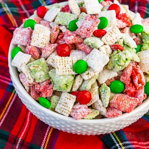 Let's not leave the reindeers out this holiday season by making them their own special Reindeer Chow {aka Christmas Puppy Chow}! This holiday party mix recipe is filled with festive white, red, and green to celebrate the season!! Perfect for your Christmas parties or gift exchanges with neighbors and friends.