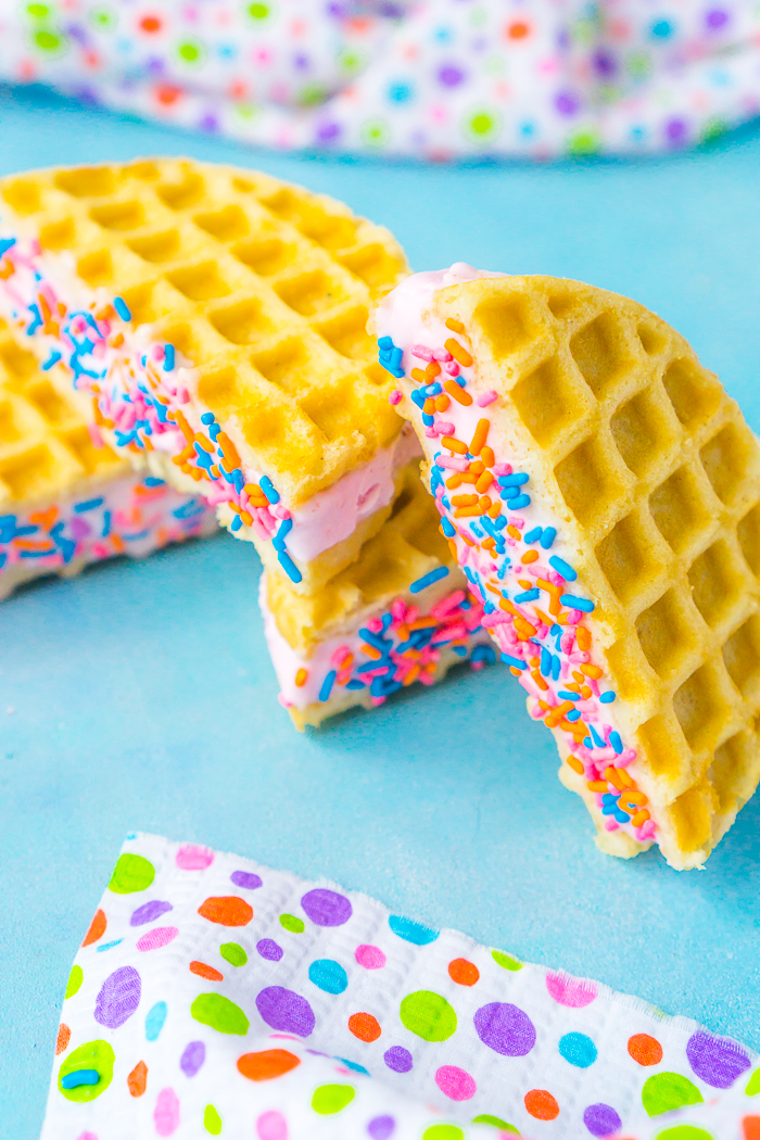 These Waffle Ice Cream Sandwiches are a delicious gluten free dessert recipe that kids and adults will love all summer long! These also make the perfect twist to an ice cream bar with tons of fun ways to customize your homemade ice cream sandwiches!  | THE LOVE NERDS