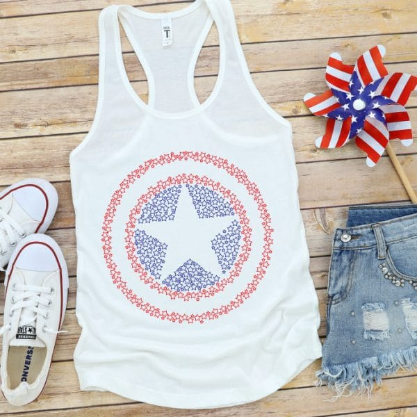 White tank top with a red and blue Captain America Shield design made up of stars showcased with 4th of july pinwheel!