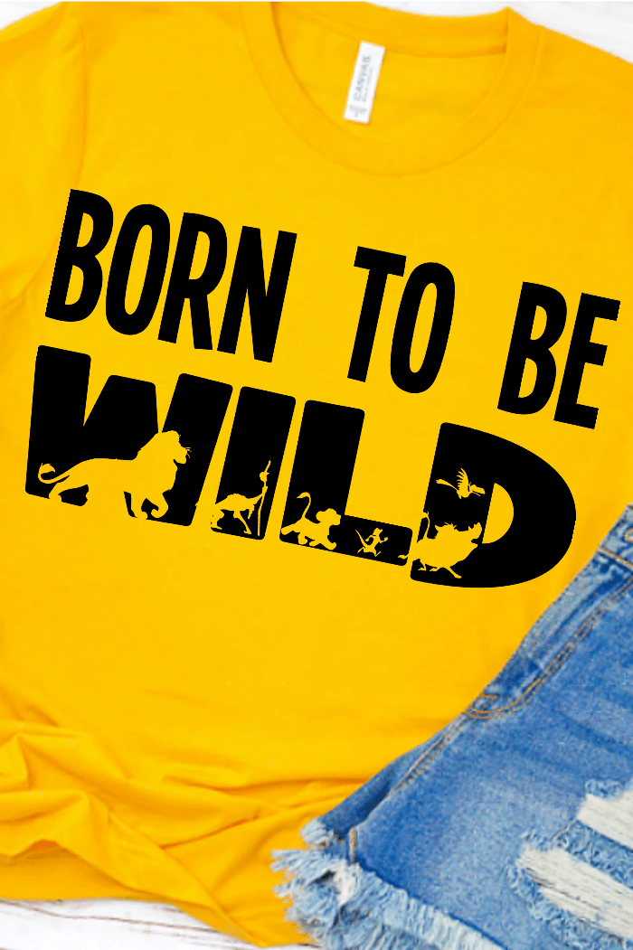 Yellow shirt with a black heat transfer vinyl design that says born to wild with lion king characters cut out
