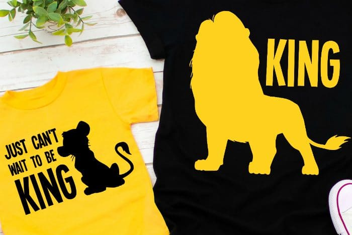 Yellow kid shirt with a black heat transfer vinyl design that says Just Can't Wait to be King with a young Simba silhouette next to a black adult shirt with yellow heat transfer vinyl that says King with Mufasa's silhouette.