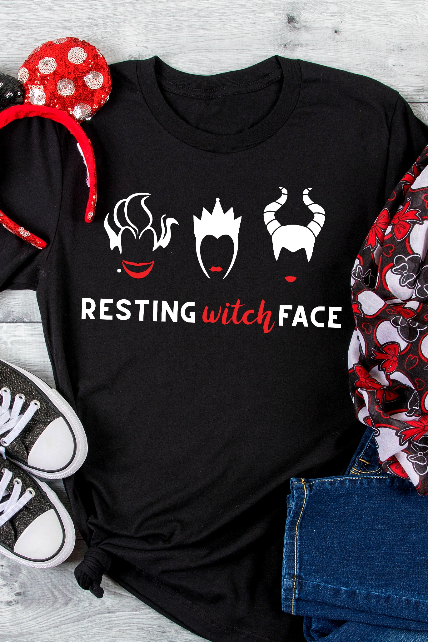 Black tshirt sits next to red and white sequined polka dot ears for Minnie Mouse and a black, red and white minnie scarf with a white and red vinyl design on it. Design says Resting Witch Face with faces of ursula, Evil Queen and Maleficent above the words.