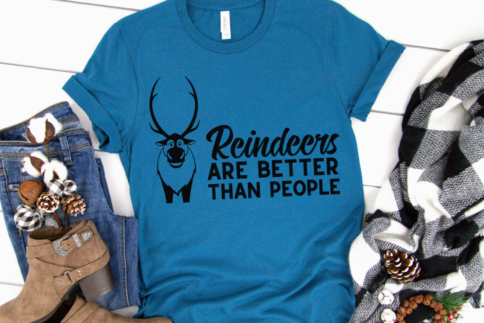 """Blue tshirt with iron on vinyl design with sven from Frozen movie and the phrase """"reindeers are better than people"""""""