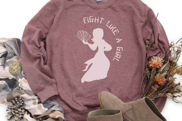 Mauve sweatshirt with a light pink Mulan with fan design that says Fight like a Girl.